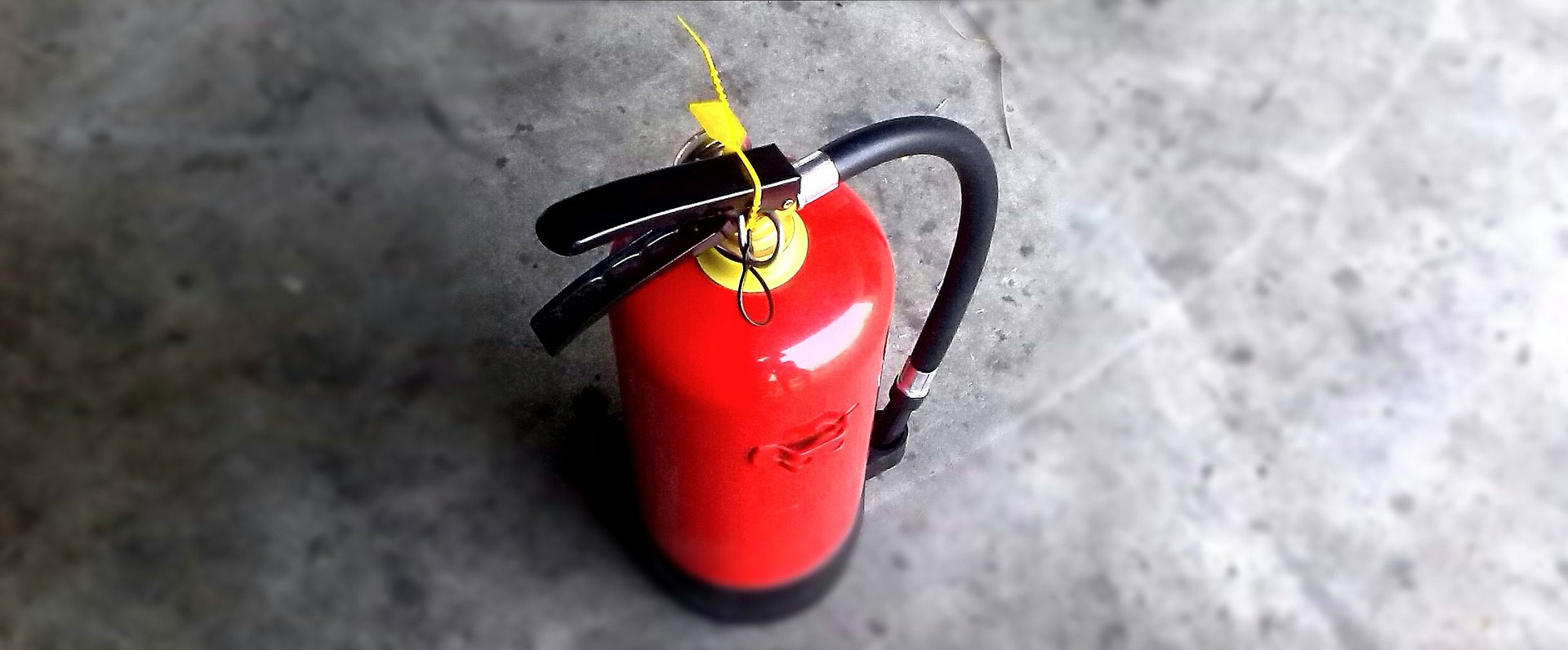 A photo of a fire extinguisher: WA Fire - Workplace Fire Safety